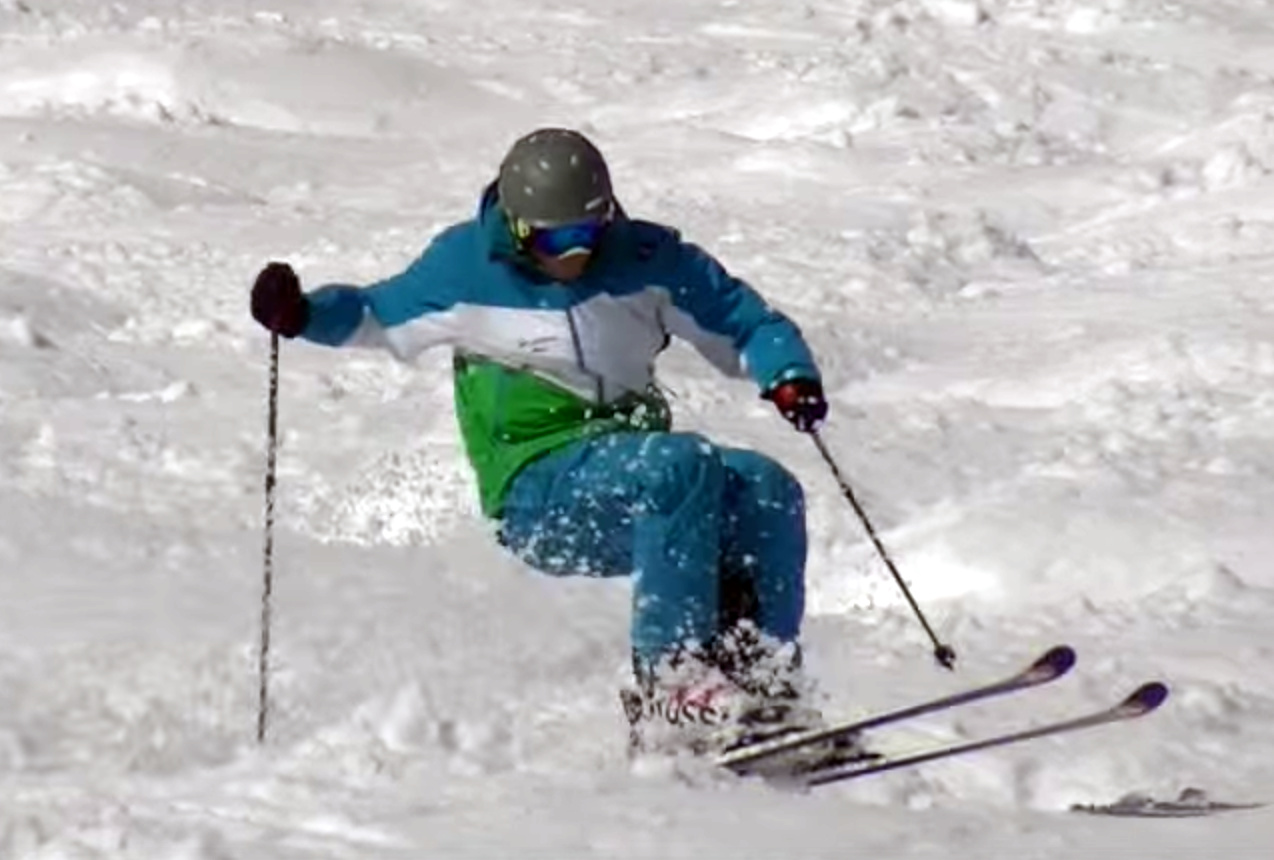Controlling angular momentum with a blocking pole plant. Skier: Andreas S